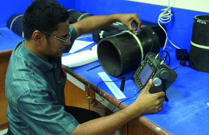 Student inspecting a circumferential weld using ul
